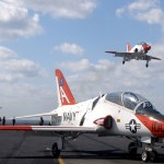 A T-45 Goshawk training aircraft is waved off from making an arrested landing aboard the aircraft carrier USS Theodore Roosevelt (US Navy photo)