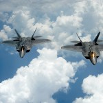 A pair of F-22 Raptors pulls away and flies behind a KC-135 Stratotanker after receiving fuel off of the East Coast on July 10, 2012. The 1st Fighter Wing at Joint Base Langley-Eustis, Va., received their first two Raptors in January 2005 and the wing's 27th Fighter Squadron was designated as fully operational in December 2005. The Raptors belong to the 27th FS and the KC-135 belongs to the 756th Air Refueling Squadron at Joint Base Andrews Naval Air Facility, Md. (U.S. Air Force photo by Master Sgt. Jeremy Lock)