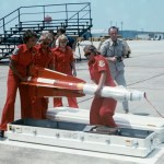 "A U.S. Air Force all female weapons load team assigned to the 119th Fighter Wing ""The Happy Hooligans"", North Dakota Air National Guard, handle an inert AIM-4C Falcon air-to-air missile during the ""William Tell"" weapons competition at Tyndall Air Force Base, Florida (USA), in October 1972. (US Air Force photo)"