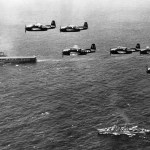 Six U.S. Navy Grumman TBM-3E Avenger anti-submarine aircraft of Composite Squadron VC-22 Checkmates flying over the Mediterranean Sea. This squadron was Attack Squadron VA-2E until 4 August 1948. Below are the aircraft carrier USS Coral Sea (CVB-43) and the Gearing-class destroyer USS Bordelon (DD-881).