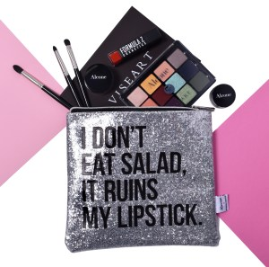 Alcone x Breakups To Makeup Lipstick Lovers Bag with makeup and brushes.