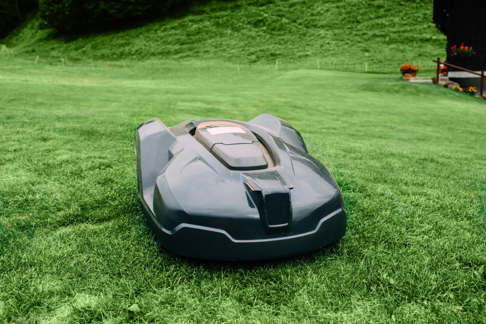 robot lawn mower cutting grass in mountains