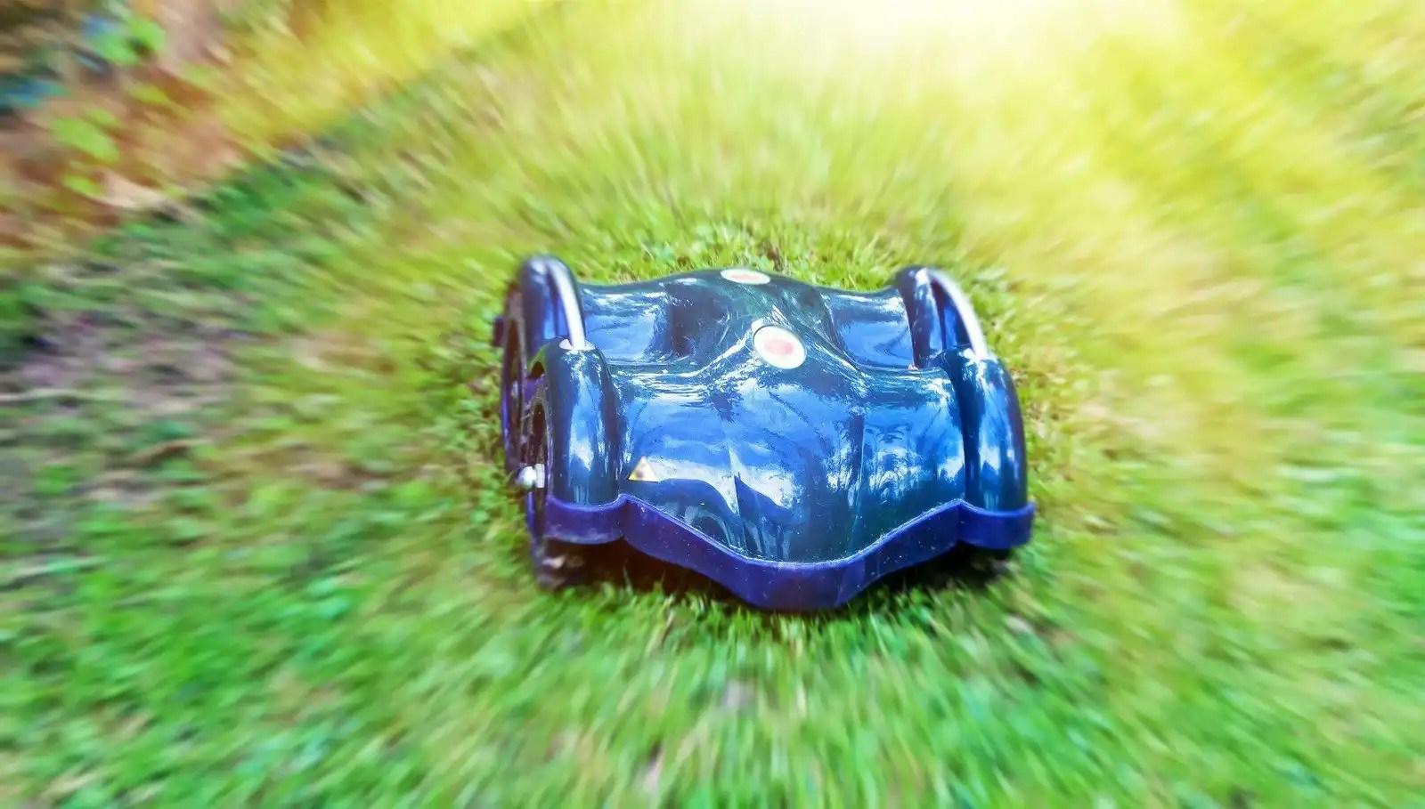 wheeled robot lawn mower cutting grass