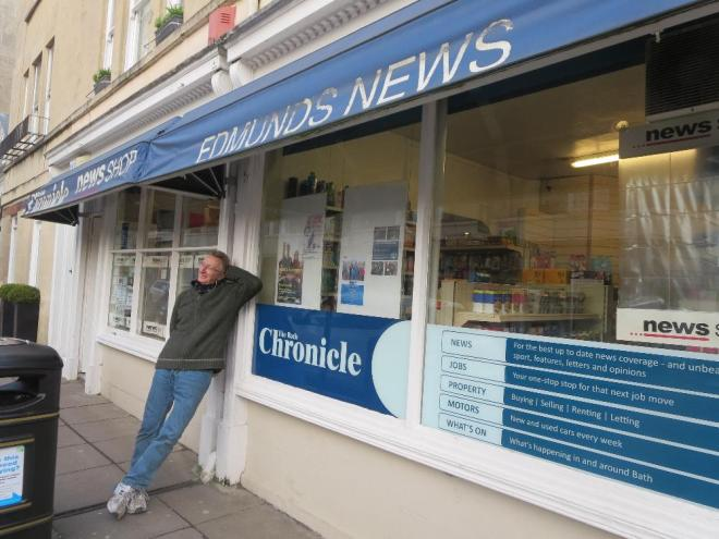 Retiring after thirty plus years at the newsagents Mick stands outside his shop