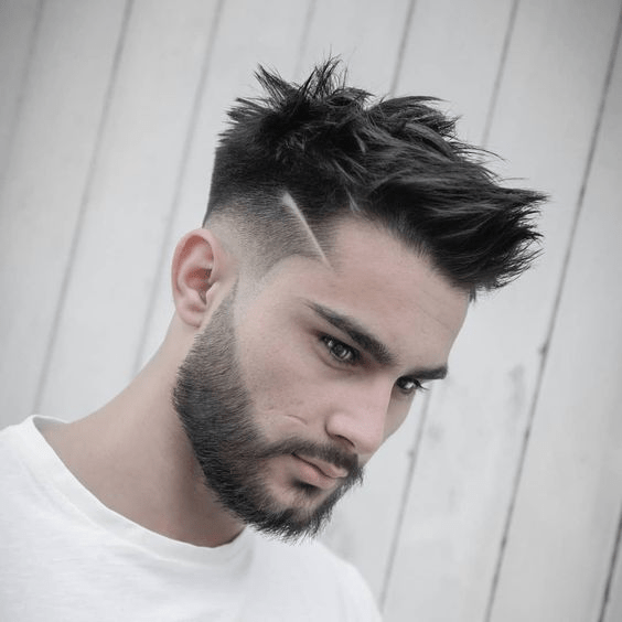 Faux hawk with small edgy shaved line
