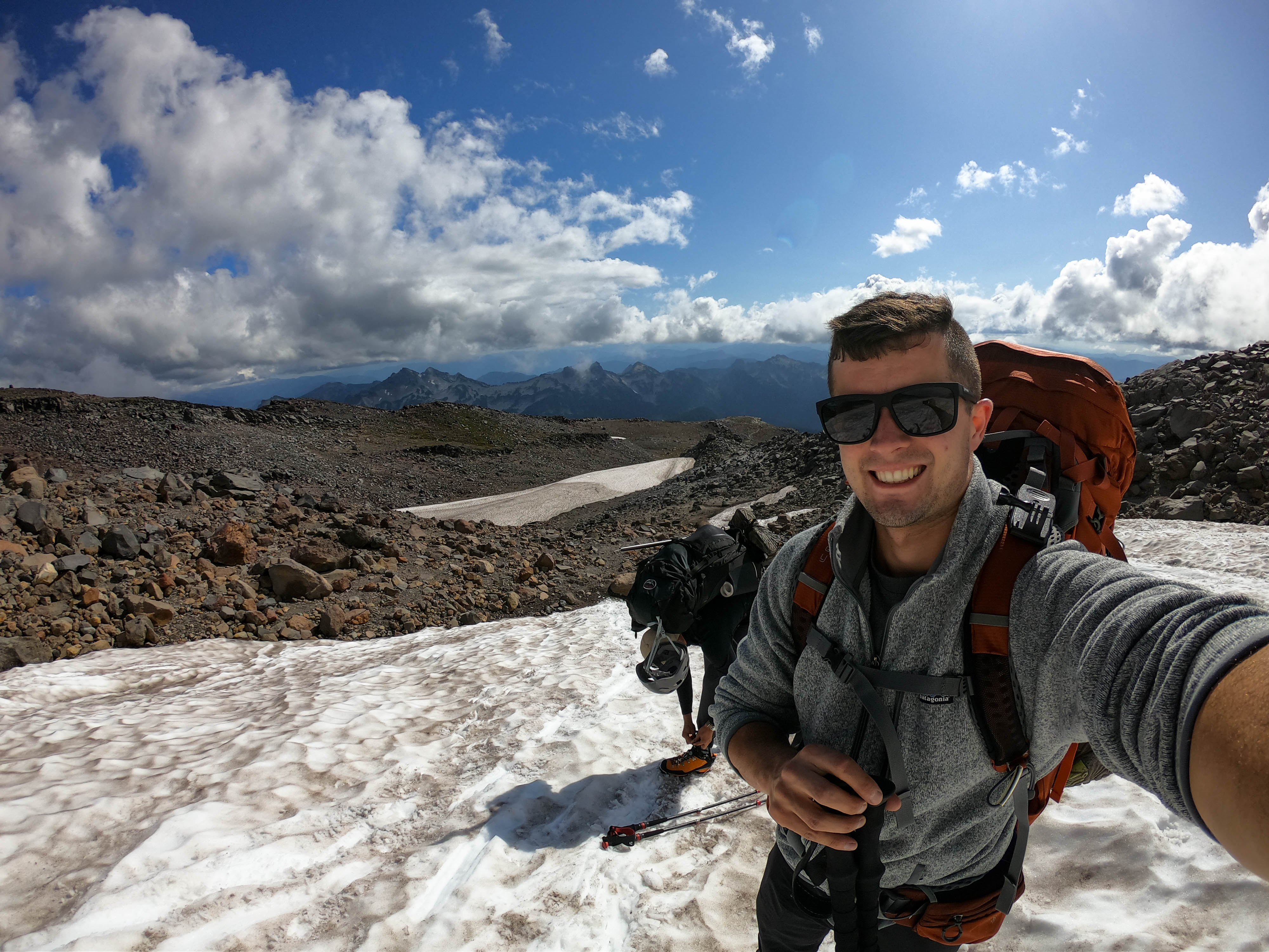 A guide to backcountry hiking. On Mt. Rainier, starting to climb up the Muir Snowfield. The weather changes quickly, as it was sunny on the bottom but completely clouded in half way to Camp Muir.