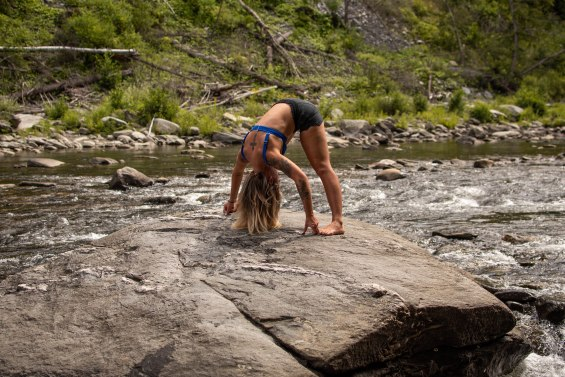 Yoga poses to transform your athleticism. [wide legged standing forward bend]