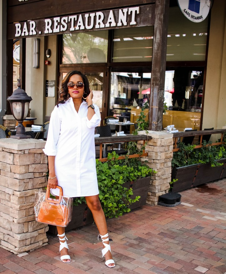 white summer dress, white shirtdress outfit, white shirtdress outfit inspo, summer dress outfit inspo, white lace up zara sandals, clear bag trend, vinyl bag trend, affordable clear bag, affordable vinyl bag, how to wear vinyl bag trend, dallas blogger, black fashion blogger, black dallas blogger