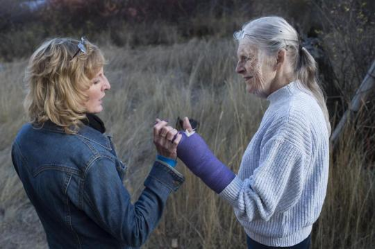 On Oct. 20, the day following Bob's death, daughter Cat Kelley holds Jane's healing arm as the two go for a walk on the Fallers' Republic, Wash., property.