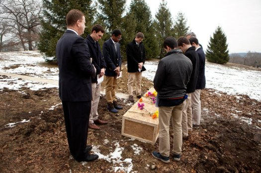 From left to right, funeral director Rob Lawler; Roxbury Latin students Emmett Dalton, Noah Piou and Chris Rota; Roxbury Latin assistant headmaster Mike Pojman, and Roxbury Latin students Brendan McInerney, Liam McDonough and Esteban Enrique conduct a graveside prayer service for Nicholas Miller on Friday at the Fairview Cemetery.