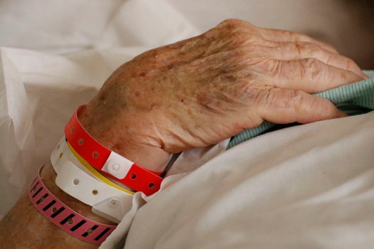 Hands of an older woman in the hospital