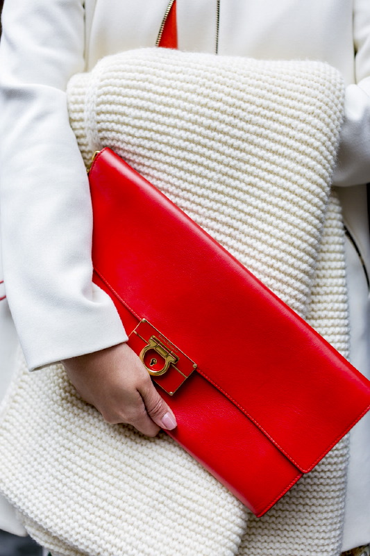 White fur and Red clutch