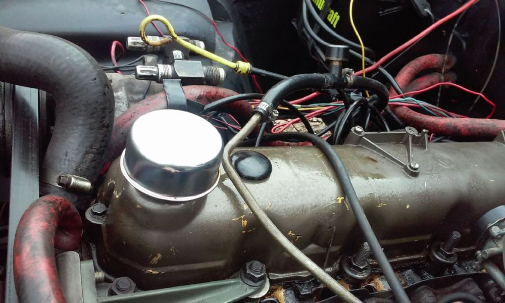medium resolution of but basically on my jeep with a 258 i added a pcv valve to the rear hole on my cover blocked the front one and added a filter to the oil fill hole