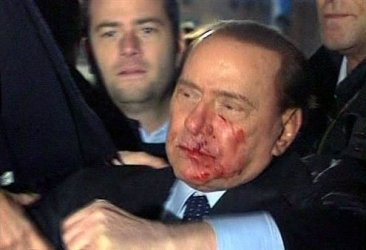 Berlusconii was struck in the face by a jagged souvenir.