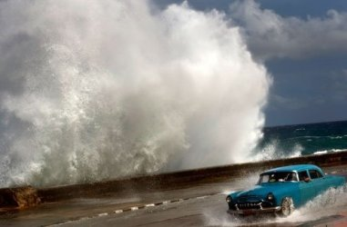 Hurricane Sandy blasted across eastern Cuba on Thursday as a potent Category 2 storm and headed for the Bahamas...