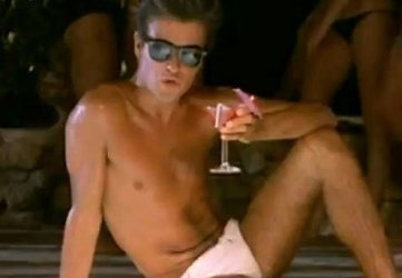 In the video, lounging in a pool and tossing away a cocktail.
