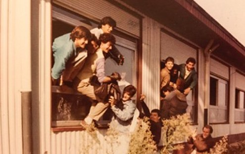The author's classmates tumbling from a classroom window.