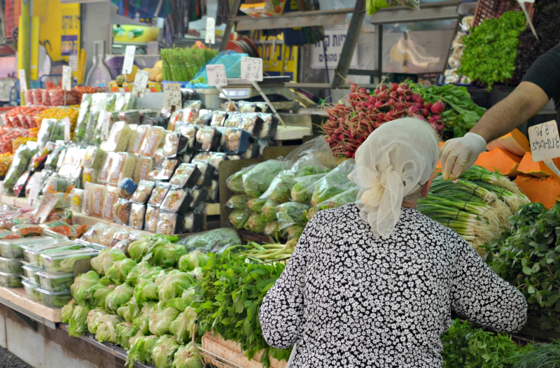 buying fruit and vegetables in a shuk in israel