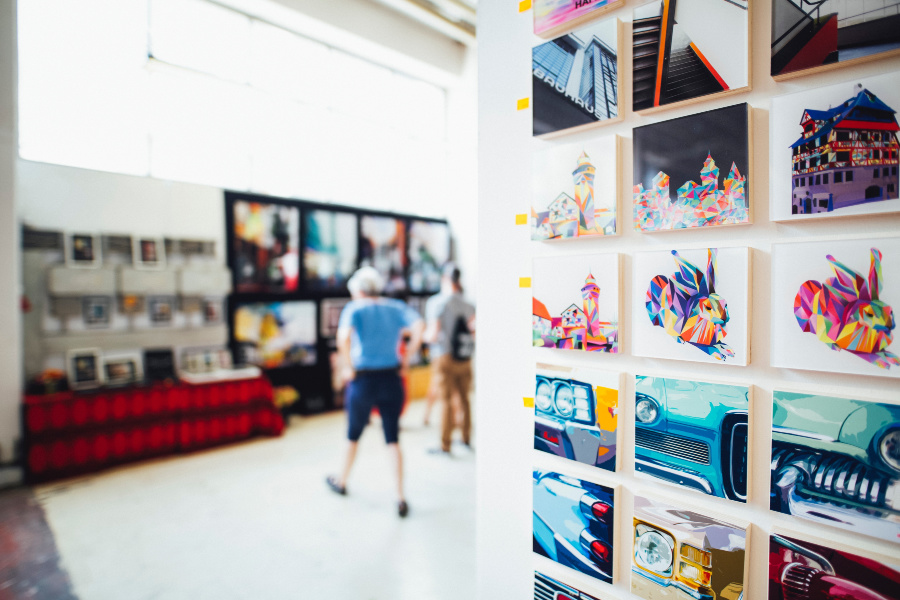 canvas photographs grouped on a wall in bright modern setting