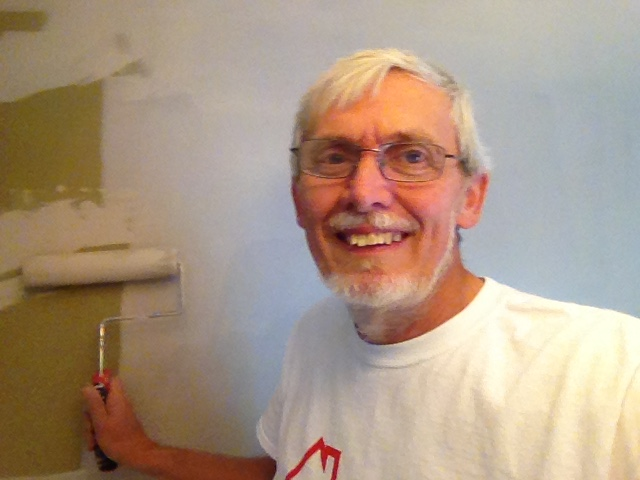 Painting a drywall repair job.