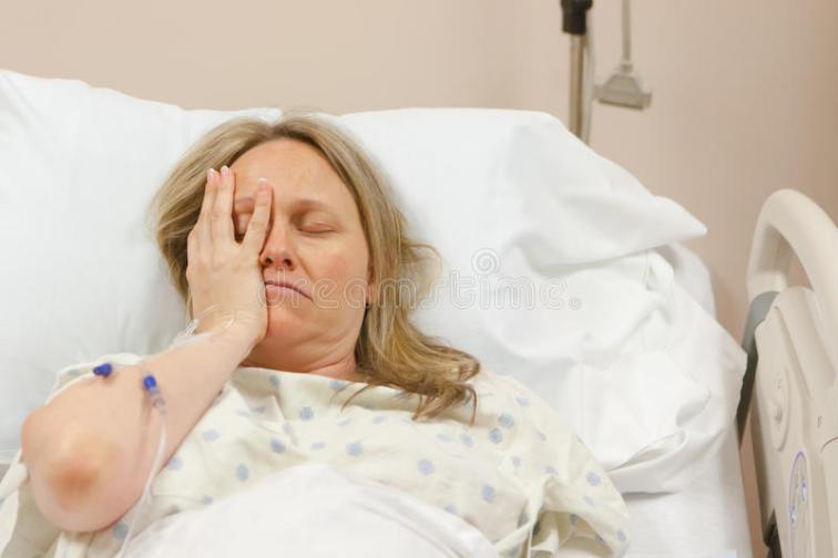 sick-woman-hospital-bed-feeling-pain-stress-56373617
