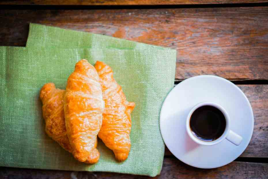 black-croissants-with-black-coffee-on-wooden-background-2