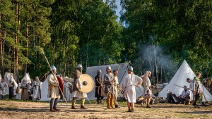 Cedynia Poland June 2019 Historical reenactment of Slavic or Vikings tribe lifestyle with warriors and villagers in a tent camp from 11th century