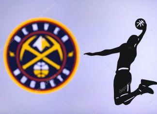 NEW YORK, USA, JUN 18, 2020: Denver Nuggets basketball club logo, silhouette of jumping basket player, sport photo NBA, edit space.