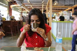 Didi sipping coffee at 7th st public market