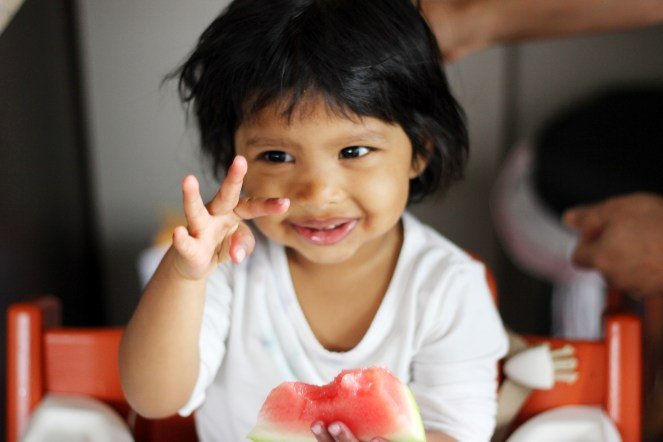 Asha showing she is two with her fingers