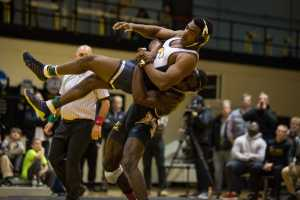 App State's Randall Diabe takes the Moc's Clay Dent to the mat to prevent an escape.