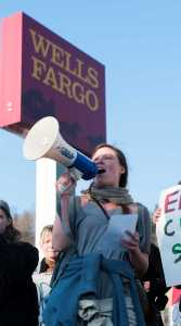 Protestors gathered at the Wells Fargo for over two hours, chanting, singing and spreading the word.