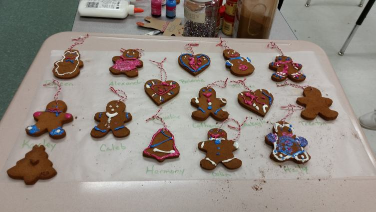 Use puffy paint to add decorations to your cinnamon ornament. This makes them look like special christmas cookies!