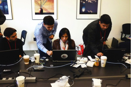 Sarahi Mireles (@sarahimireles), center, makes something happen on Twitter with Raspberry Pi, and all the guys cheer.