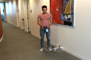 Luis flying his quadcopter.