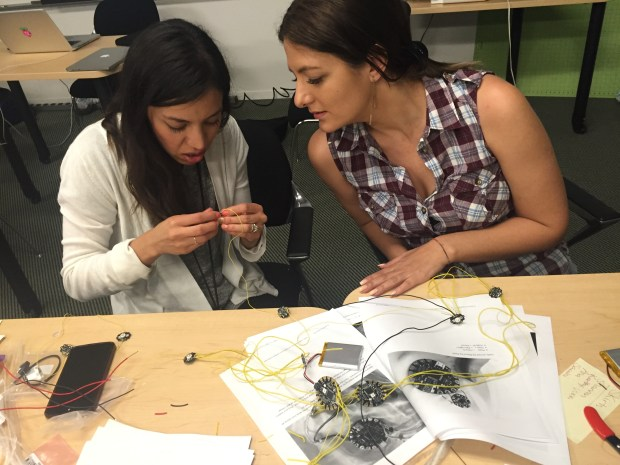 Sarahi Mireles (@sarahimireles) and Ana Tomescu (@annatomescu) work on that fiber-optic pixie skirt.
