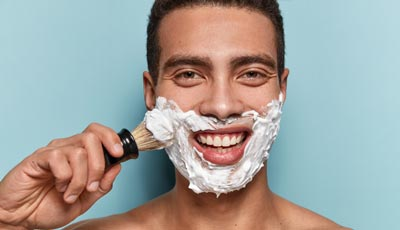 Man using shaving cream for shave