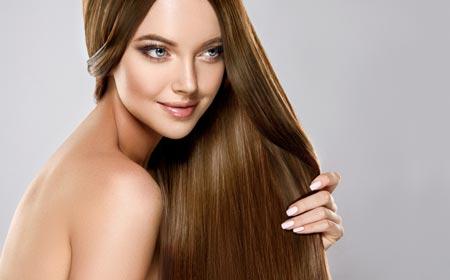 Girls holding her shiny hair