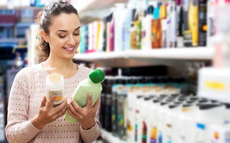 Girl choosing shampoo for keratin treated hair