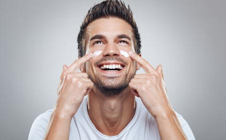 Men using moisturizer in stubble area