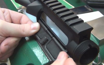 AR-15 Ejection Port Cover Assembly - thearmsguide.com