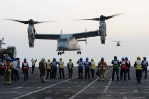 USMC Osprey. HMS Illustrious. Multinational teams require trust for mission command to work