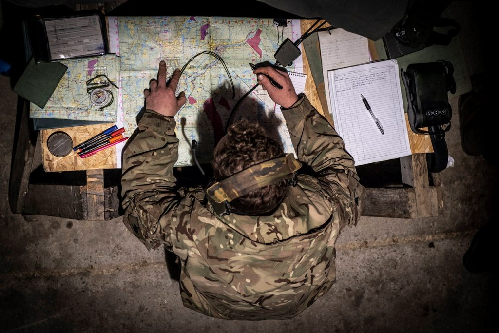 Soldiers from the Light Dragoons Cavalry Regiment stay under the cover of a civilians barn to use as an observation post during a Command Post exercise.  Corporal Ben Beale/ MoD Crown Copyright under OGL