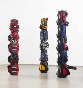 Brian Jungen   '1980,' '1970,' and '1960' (2007), golf bags with golf balls and painted golf tees, 139, 151 and 156 in. high, Art Gallery of Ontario