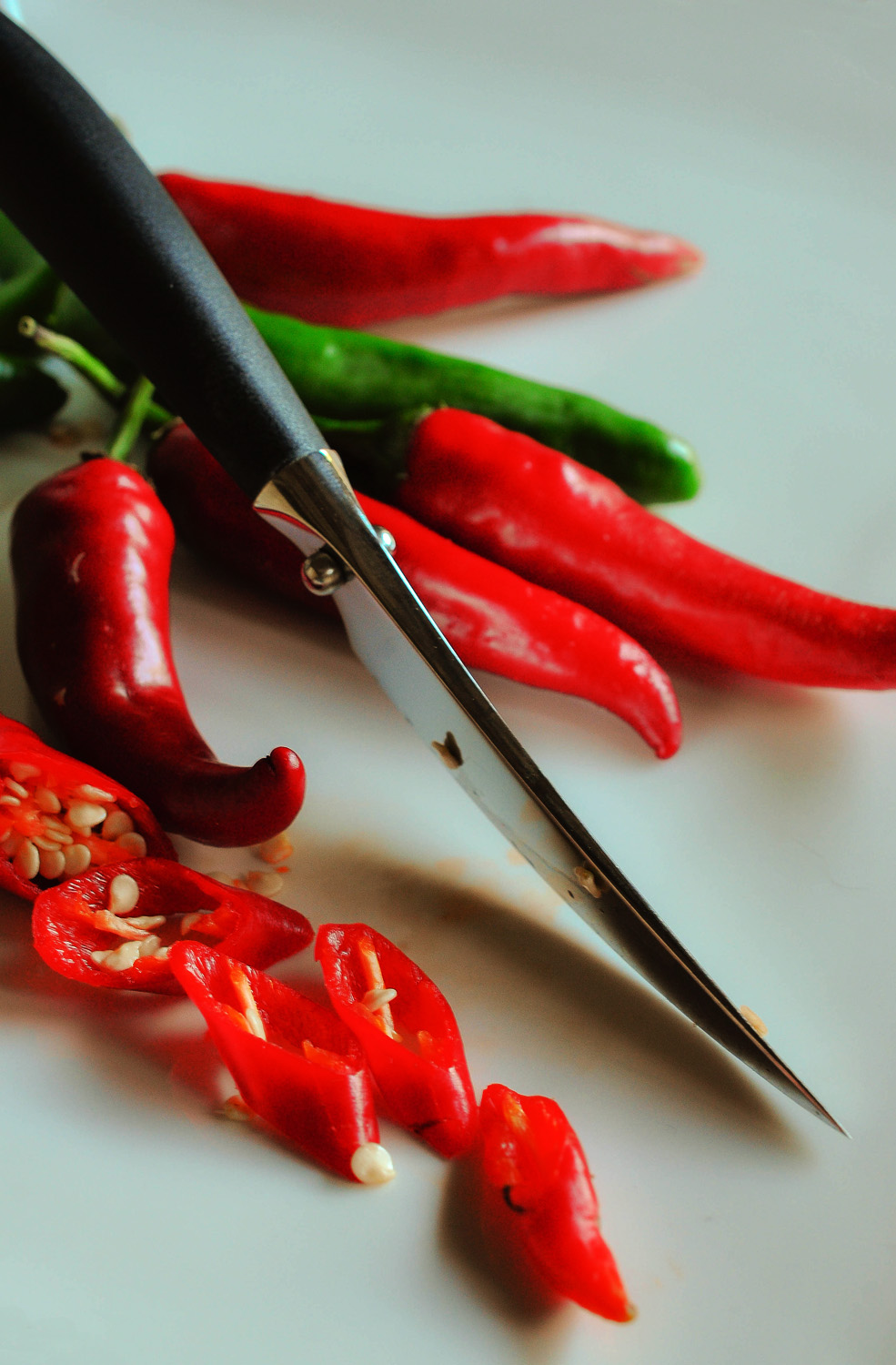 Chillies knife and white plate