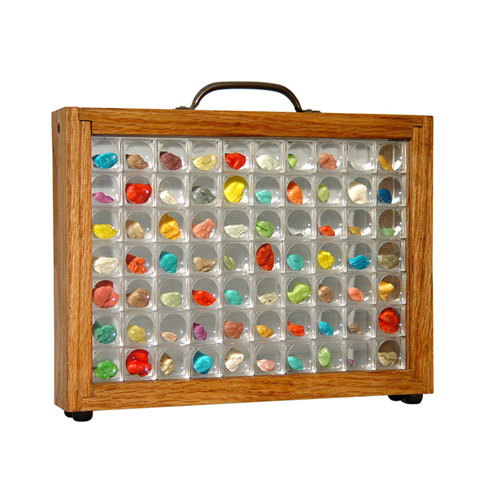 Wood, glass, plastic magnifiers, chewed gum, 9 x 12 x 12 inches