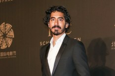 """BEIJING, CHINA - APRIL 18: Actor and IWC Ambassador Dev Patel attends IWC's """"For the Love of Cinema"""" Gala, held during the 2017 Beijing International Film Festival at the Imperial Ancestral Temple, just outside Beijing's Forbidden City. (Photo by Emmanuel Wong/IWC Schaffhausen via Getty Images) *** Local Caption *** Dev Patel"""
