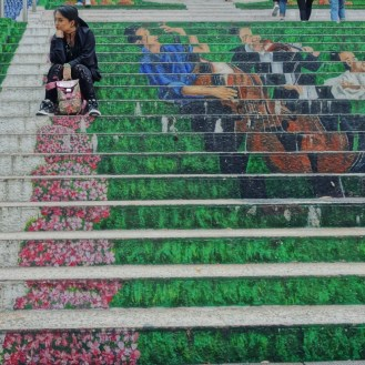 having fun in HONG KONG. My GUCCI blooms back pack matched the staircase art.
