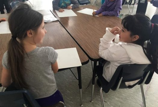 students talking in pairs