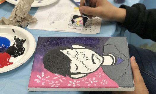 Image of student working on Self portrait